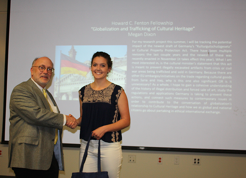 Professor and Department Chair Mark A. Meadow congratulating Megan Dixon on receiving the Howard C. Fenton Fellowship Award