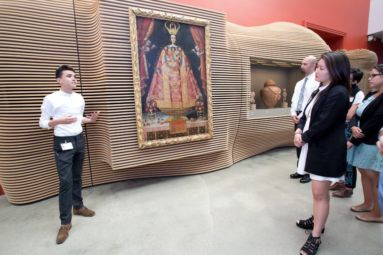 Saúl Quintero presenting an artwork from LACMA's collection to the 2014 Mellon Summer Academy group.