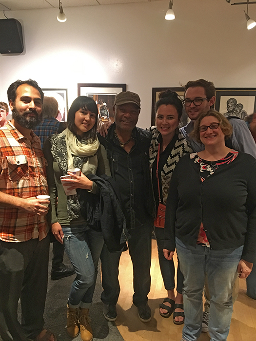 "Emory Douglas, former Minister of Culture of the Black Panther Party (center), with Dr. Jenni Sorkin (far right) and graduate students, at the ""50 Years Strong and Counting: The Revolutionary Art of the Black Panther Party"" Reception (MultiCultural Center, UCSB, November 14, 2016)"